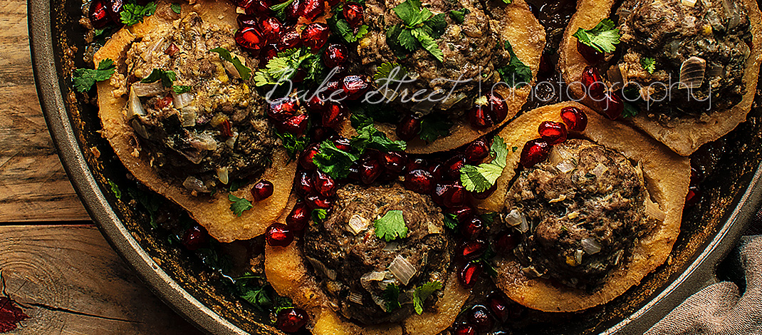 Lamb stuffed quinces with pomegranate and cilantro