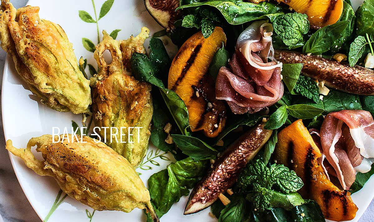 Stuffed squash blossoms with grilled peach salad